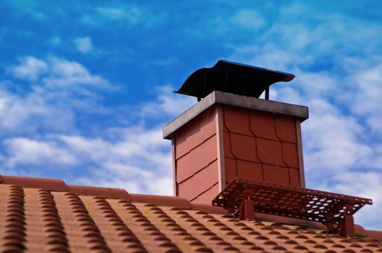 Here is a chimney in Philadelphia, PA recently serviced with a chimney sweep. Blue sky and clouds are in the background.